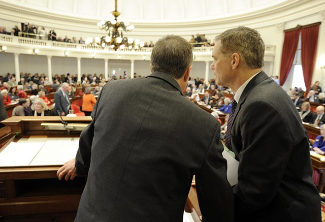 Lt. Gov. Phil Scott and Senate Secretary John Bloomer confer as legislators cast ballots. - JEB WALLACE-BRODEUR