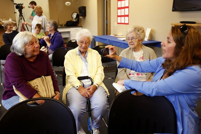 Lynn Monty interviews Sally Young of Milton as she sits with Jane Lafayette (center) and Ruth Marcoux, all of Milton, last September. - COURTESY OF ANTHONY BOCCIO