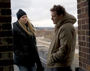 MAD LOVE Phoenix juggles mental problems and girl troubles in James Gray's romantic drama.