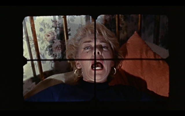 Mark's first victim — as seen from his / his camera's / Michael Powell's / our point of view — in Peeping Tom - ANGLO-AMALGAMATED FILM DISTRIBUTORS