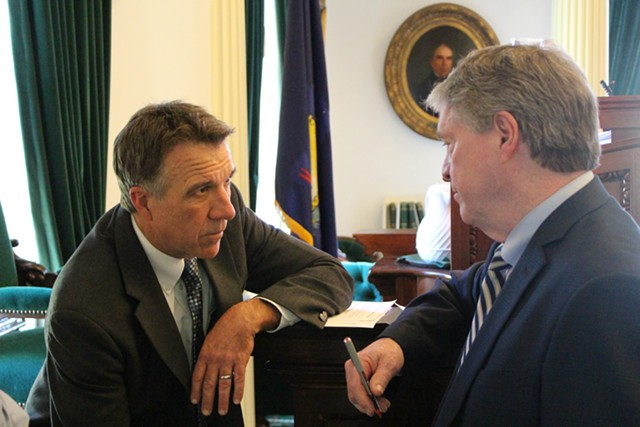 Lt. Gov. Phil Scott and Senate President Pro Tem John Campbell confer Thursday in the Senate. - PAUL HEINTZ