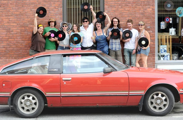 Members of the Cheap Thrills Record Club in front of Buch Spieler Music