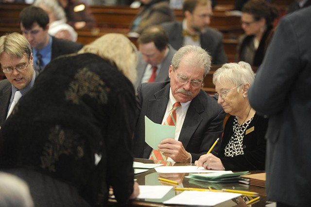 Members of the legislature's canvassing committee tally ballots. - JEB WALLACE-BRODEUR