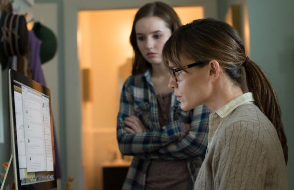 Click To Enlarge Net Loss Garner Plays A Humorless Overzealous Mom Who Controls All Her Daughters Online