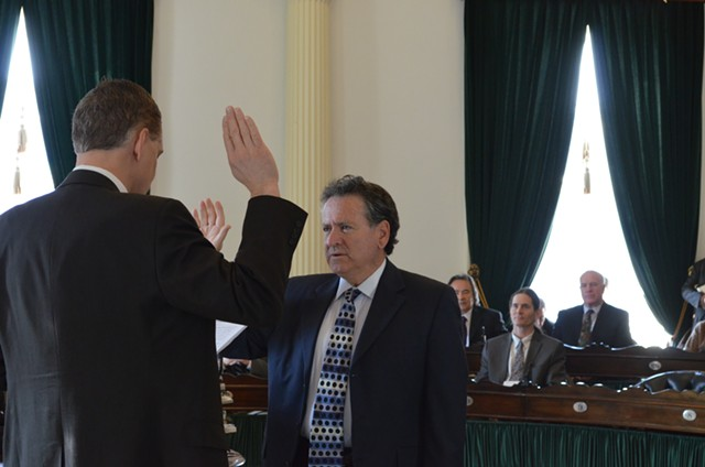 Michael Sirotkin, D-Chittenden, is sworn into the Vermont State Senate by senate secretary, John Bloomer. - PHOTO BY ALICIA FREESE