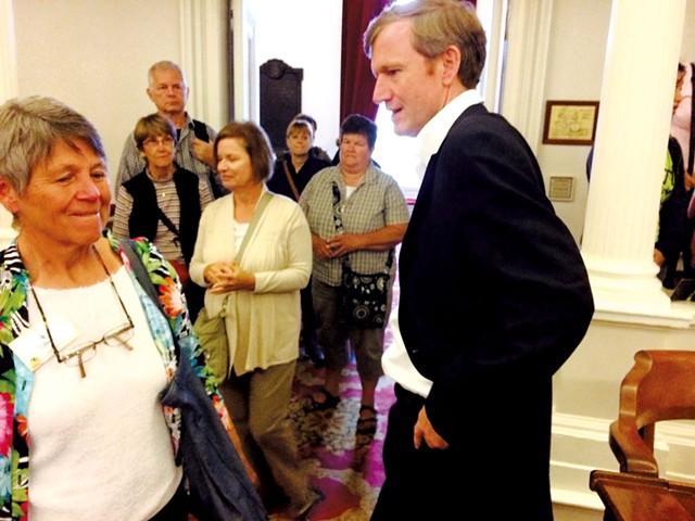 Milne greets an acquaintance on the House floor - MARK DAVIS