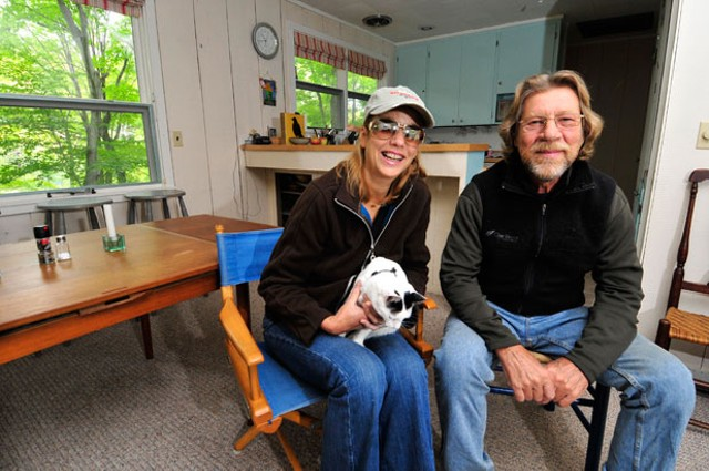 Moretown flood victims Rebecca Sykes and Gary Butler at their temporary home in a Fayston vacation rental. - JEB WALLACE-BRODEUR
