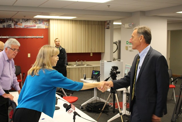 Nancy Remsen shakes Gov. Peter Shumlin's hand at last month's Burlington Free Press gubernatorial debate. - PAUL HEINTZ