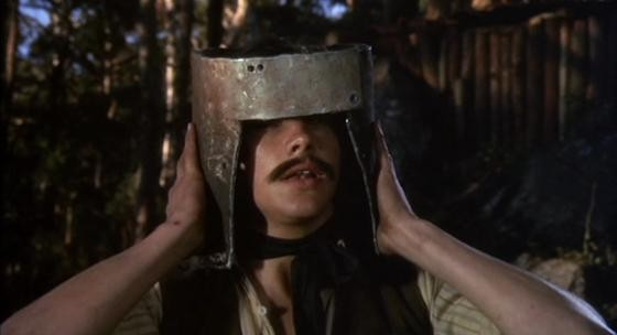 Ned tests out his homemade helmet on a comrade - MGM PICTURES