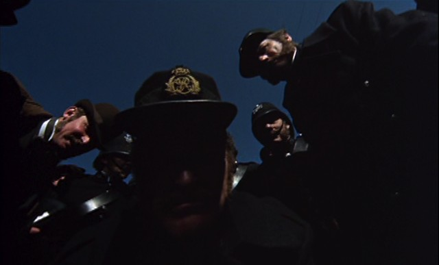 Ned's wide-angle POV as the policemen haul him into town - MGM PICTURES