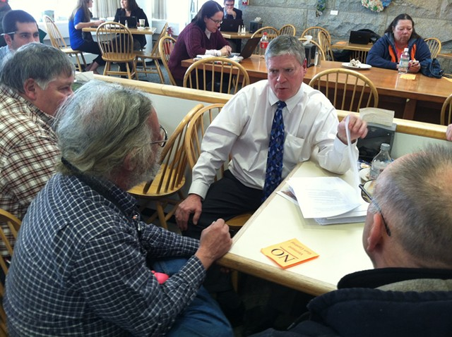 Senate President Pro Tempore John Campbell (D-Windsor) talks to Tim Ordway of Bennington (left) and other gun owners Tuesday in the Statehouse cafeteria. - TERRI HALLENBECK
