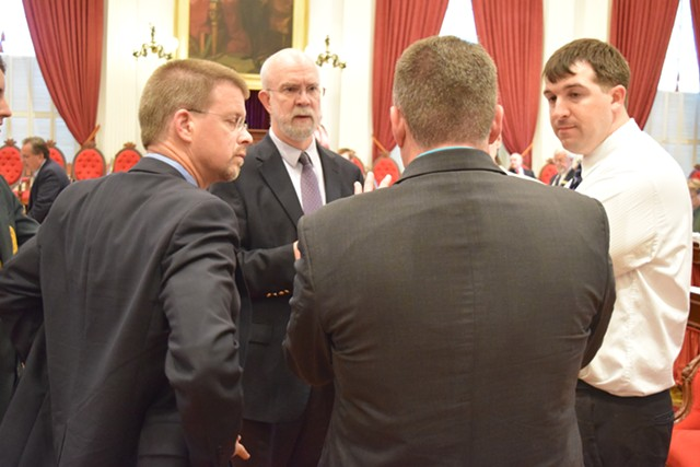 From left, House Speaker Shap Smith, Health Care Committee chair Bill Lippert, Rep. Paul Dame and House Minority Leader Don Turner discuss vaccination legislation on the House floor Tuesday. - TERRI HALLENBECK