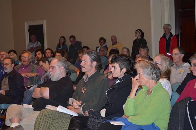 Burlington residents listen to Tom Angotti speak at Contois Auditorium. - ALICIA FREESE