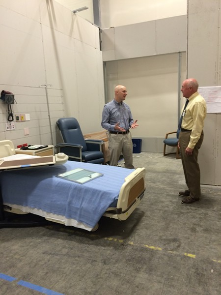 Architect Thomas Morris explains some of the special features in a mock patient room proposed for new medical center tower to Mike Noble, University of Vermont Medical Center media strategist. - NANCY REMSEN
