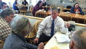 Senate President Pro Tempore John Campbell (D-Windsor) talks to Tim Ordway of Bennington (left) and other gun owners Tuesday in the Statehouse cafeteria.
