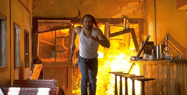 Nicolas Cage outrunning one of many explosions in Con Air - TOUCHSTONE PICTURES