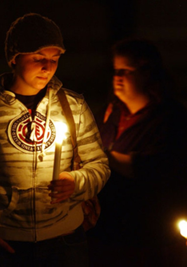 """Nicole Proulx of Plainfield holds a candle during a """"Take Back the Night"""" vigil in Montpelier - JEB WALLACE-BRODEUR"""