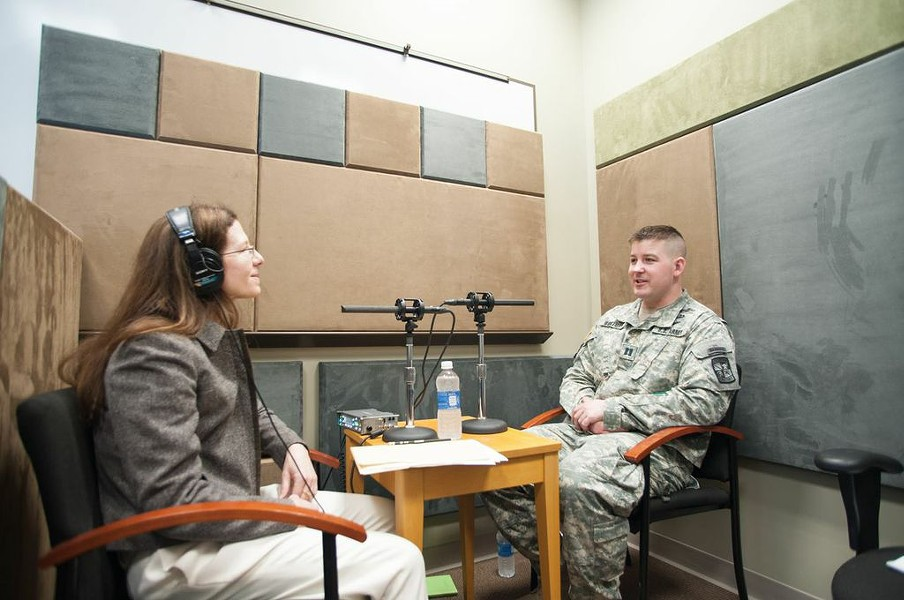 Norwich Voice Oral History project coordinator Jennifer Payne interviewing Captain Gregory R. Wortman - MARK COLLIER / NORWICH UNIVERSITY