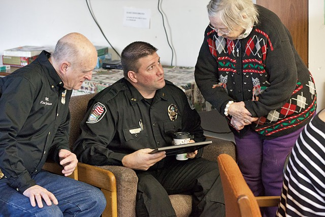 Officer Ron Jackson and Police chief Rick Hebert with Luella Murton at the Coffee With a Cop gathering at the Spring Gardens senior home - MATTHEW THORSEN