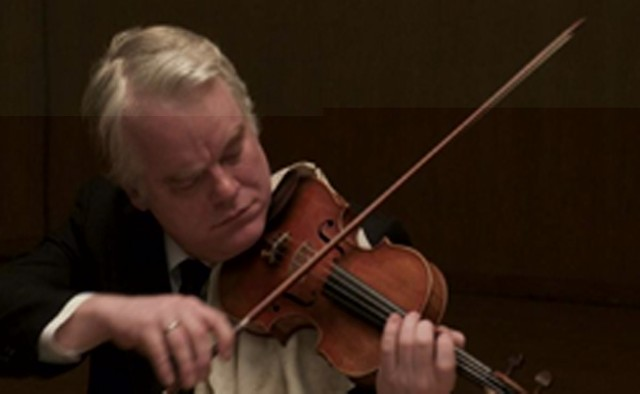 Philip Seymour Hoffman plays the violin, because he can do everything, in A Late Quartet.