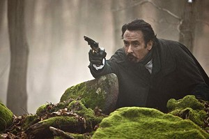 PISTOL-PACKIN'' POE Cusack plays the writer in a silly thriller that misfires at every turn.