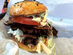 Pork belly sandwich on homemade bun - ALICE LEVITT