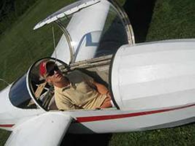 Quincy McDougal sitting in a glider