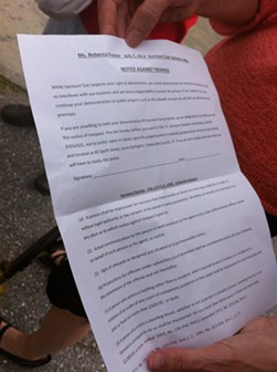 Rebecca Foster displays the official notice against trespass issued against the protestors. - KATHRYN FLAGG