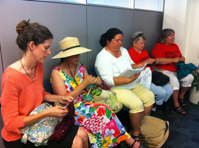 """Rebecca Foster, Jane Palmer, Maren Vasatka, Claire Broughton and Mary Martin stage a """"knit-in"""" at Vermont Gas headquarters in South Burlington. - KATHRYN FLAGG"""