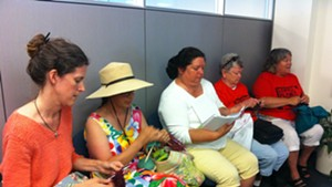 """Rebecca Foster, Jane Palmer, Maren Vasatka, Claire Broughton and Mary Martin stage a """"knit-in"""" at Vermont Gas headquarters in South Burlington."""