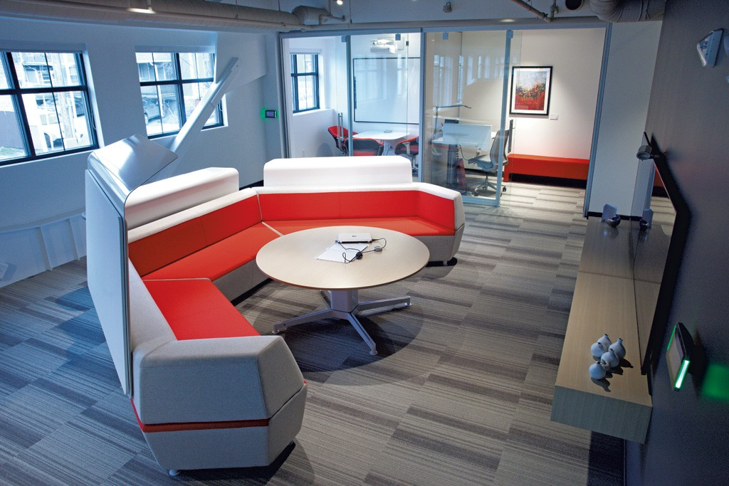 Red Thread's Burlington showroom has couches for lounging and impromptu meetings outside of glassed-in workstations for privacy. - MATTHEW THORSEN