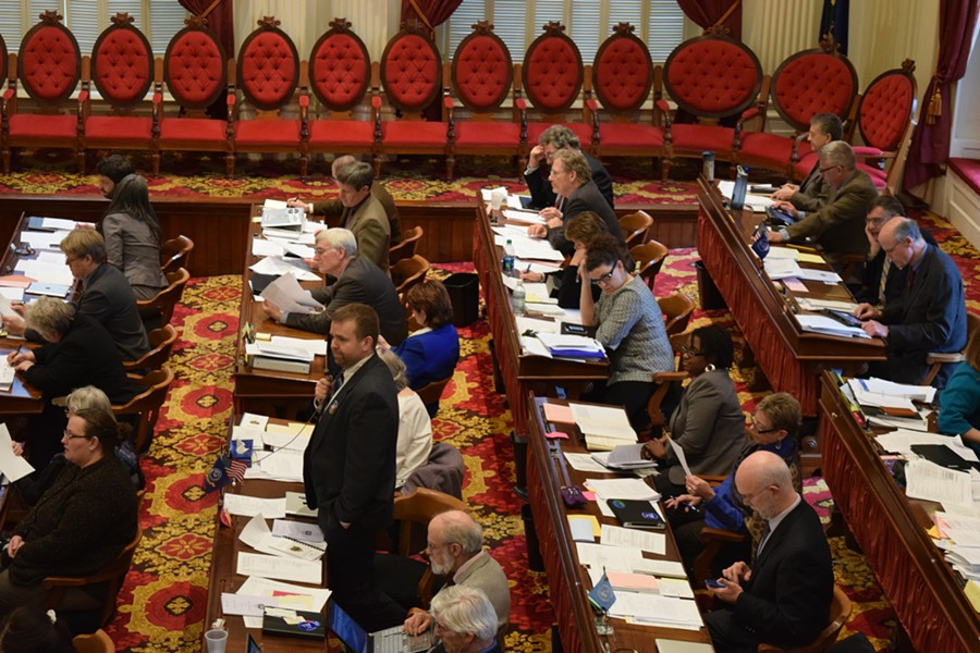Rep. Job Tate (R-Mendon), standing, proposes cutting legislative pay during debate on the budget bill Friday on the House floor. - TERRI HALLENBECK