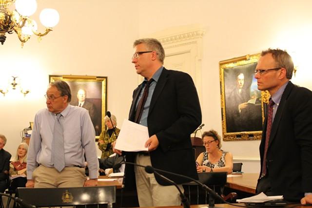 Reps. Paul Poirer, Tom Stevens and Willem Jewett address the House Democratic Caucus - PAUL HEINTZ