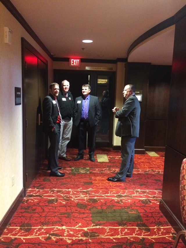 Republicans stand outside the luncheon, including Vermont Republican Party campaign director Jeff Bartley (far left), Sen. Joe Benning and Rep. Don Turner. - ALICIA FREESE