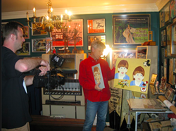 Rick Staton displays a painting Gacy created based on a photo of Staton's son. That, he acknowledges, really creeped him out.