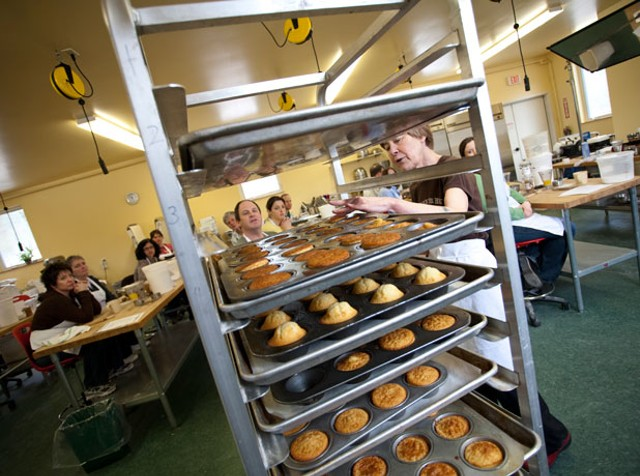 Rosemary Hubbard checks on racks of doughnut muffins