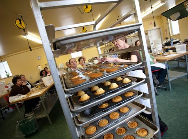 Rosemary Hubbard checks on racks of doughnut muffins