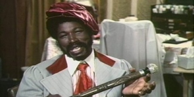 Rudy Ray Moore as Petey Wheatstraw - (note tin-foil-topped magic cane)