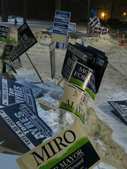 Campaign signs outside a polling station - MATTHEW THORSEN