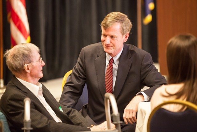Scott Milne talks with his father, Donald Milne, as election results are reported. - OLIVER PARINI