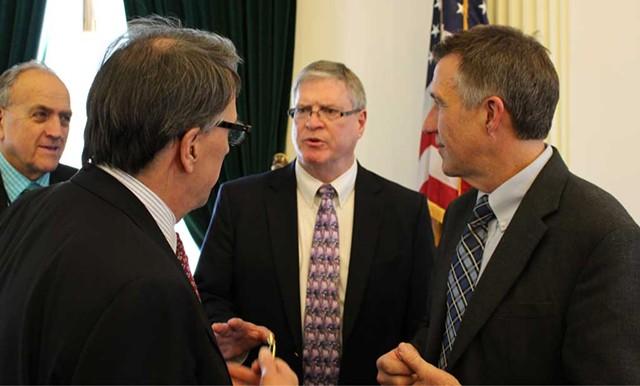 Sen. Peter Galbraith, Sen. John Campbell and Lt. Gov. Phil Scott conference on the Senate floor. - COURTESY OF PAUL HEINTZ