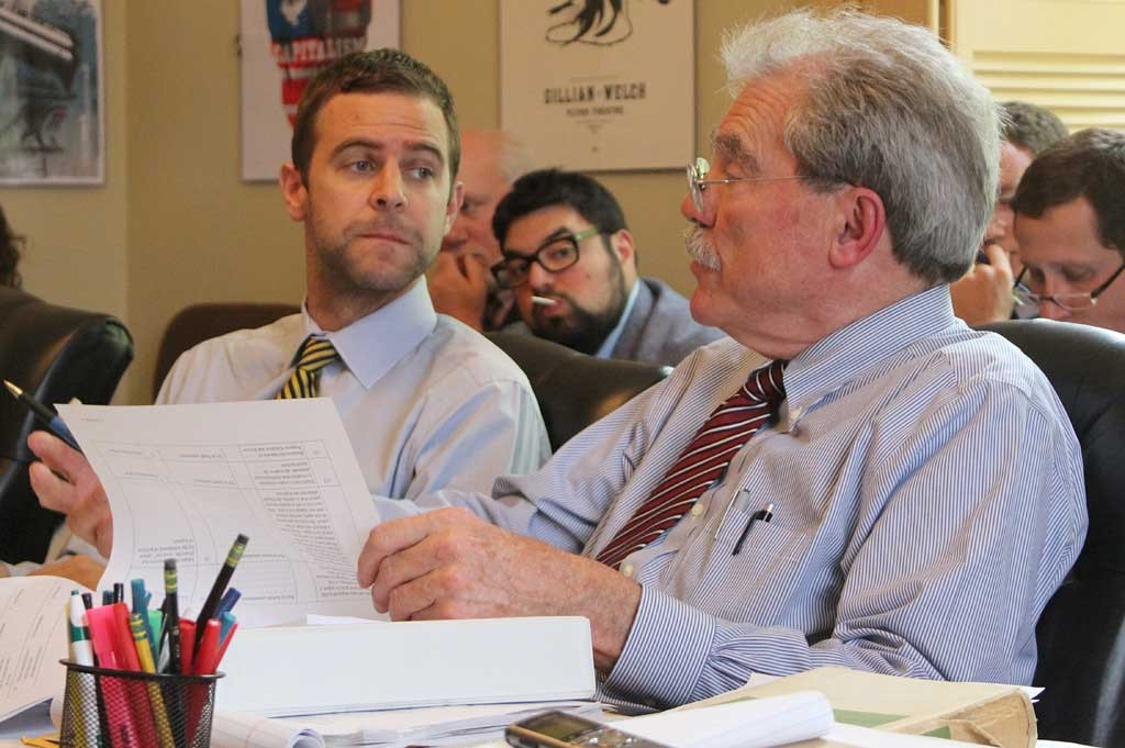 Sen. Tim Ashe, left, and Sen. Mark MacDonald prepare to sign the tax conference report Saturday afternoon. - PAUL HEINTZ