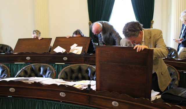 Senators clean out their desks. - PAUL HEINTZ