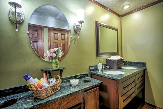 Serpentine stone countertops - COURTESY OF LUXURY EVENT RESTROOMS
