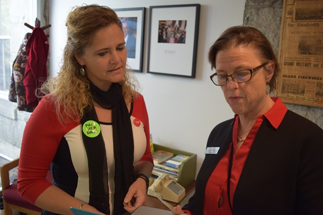House Majority Leader Sarah Copeland Hanzas (D-Bradford), left, sports a sticker supporting a paid sick leave bill as she talks Tuesday with Assistant Majority Leader Kate Webb (D-Shelburne). - TERRI HALLENBECK