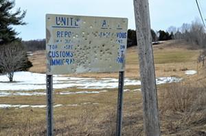Sign near a closed border crossing - MARK DAVIS