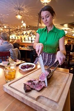 Slicing steak at Guild Tavern - MATTHEW THORSEN