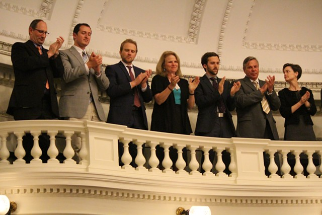 Gov. Peter Shumlin's staff applaud him from the Senate gallery. - PAUL HEINTZ