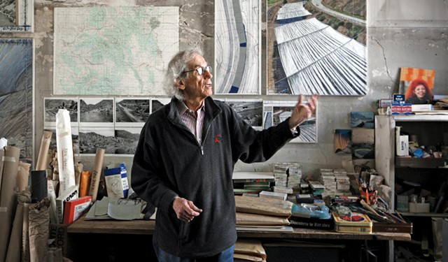 """Christo in his studio with a preparatory collage for """"Over the River,"""" 2011 - PHOTO: WOLFGANG VOLZ © 2011 CHRISTO"""