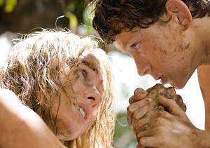 SURVIVAL THRILLS Watts and Holland cling to each other amid the tsunami's wreckage in Bayona's drama.
